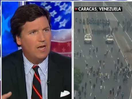 Tucker Carlson interviews Mario Diaz-Balart. Picture: Fox News