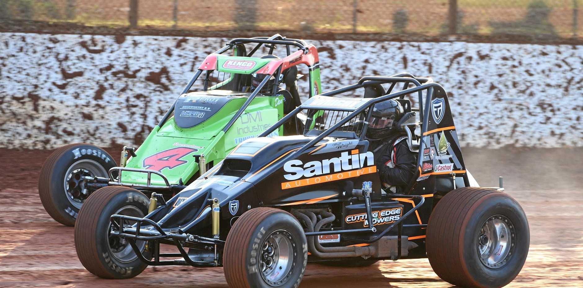 Wingless Sprints Dan Moes (4) and Matt Wright.