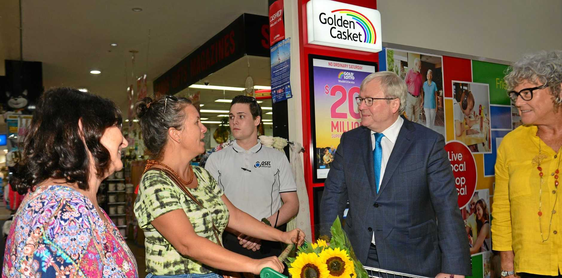 Former Labor Prime Minister Kevin Rudd with the party's Fisher candidate Julie McGlone (far right) chat to shoppers at Nambour Plaza yesterday during his flying visit to the Sunshine Coast.