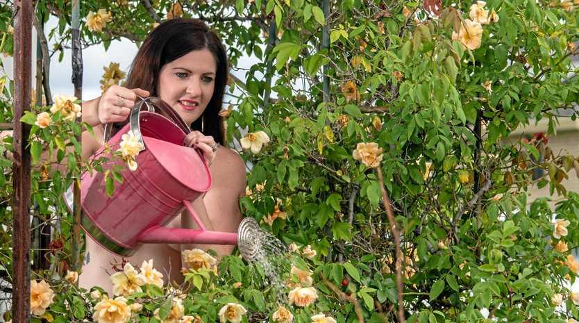 BLOOMING BEAUTUFUL: Lauren Watts, of Minden, in her garden for World Naked Gardening Day.