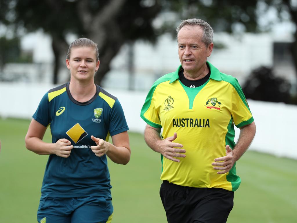 Bill Shorten and Australian spin bowler Jess Jonassen at Allan Border Field in Albion, Brisbane. Picture: Liam Kidston