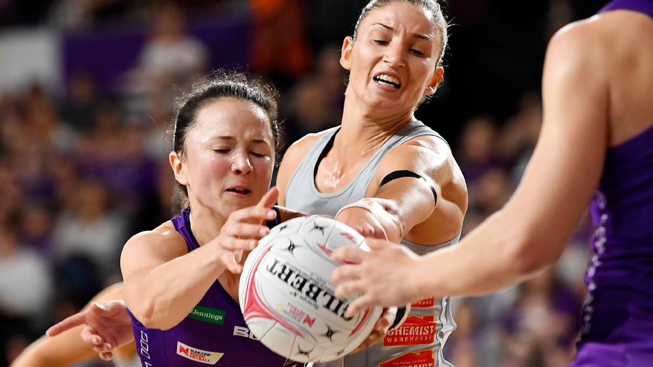 Caitlyn Nevins of the Firebirds (left) and Kim Ravaillion of the Magpies compete for the ball. Picture: AAP