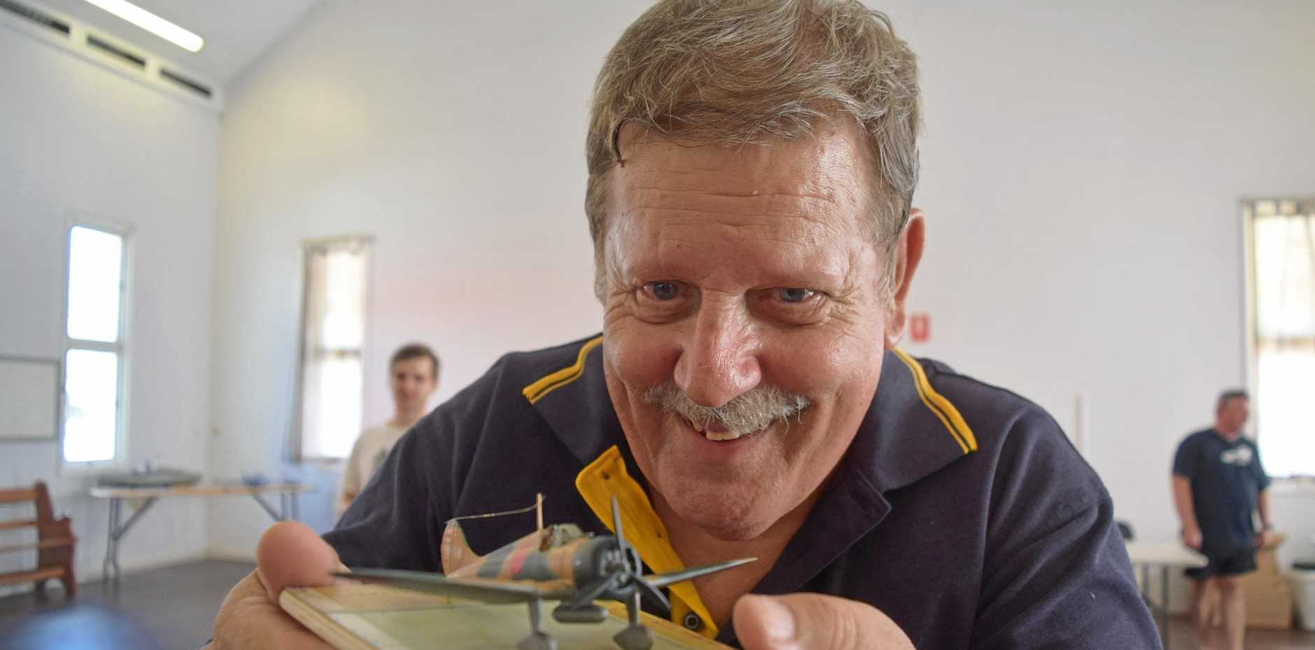 UNDERSTANDING: Derek Romans at the Mackay ModelComp with his model of a Mitsubishi A5M2 plane used in the 1930s during the Second Sino-Japanese War.