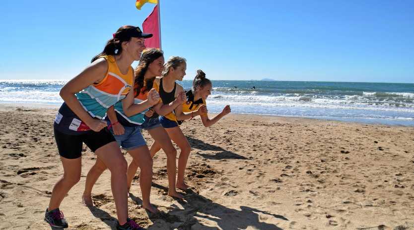 CRUSIN' THE COAST: Sam Fien, Laanie John, 13, Sophie Westcott, 13, and Ellsie Bierton, 12, line up on the sand outside the Sarina Surf Life Saving Club.