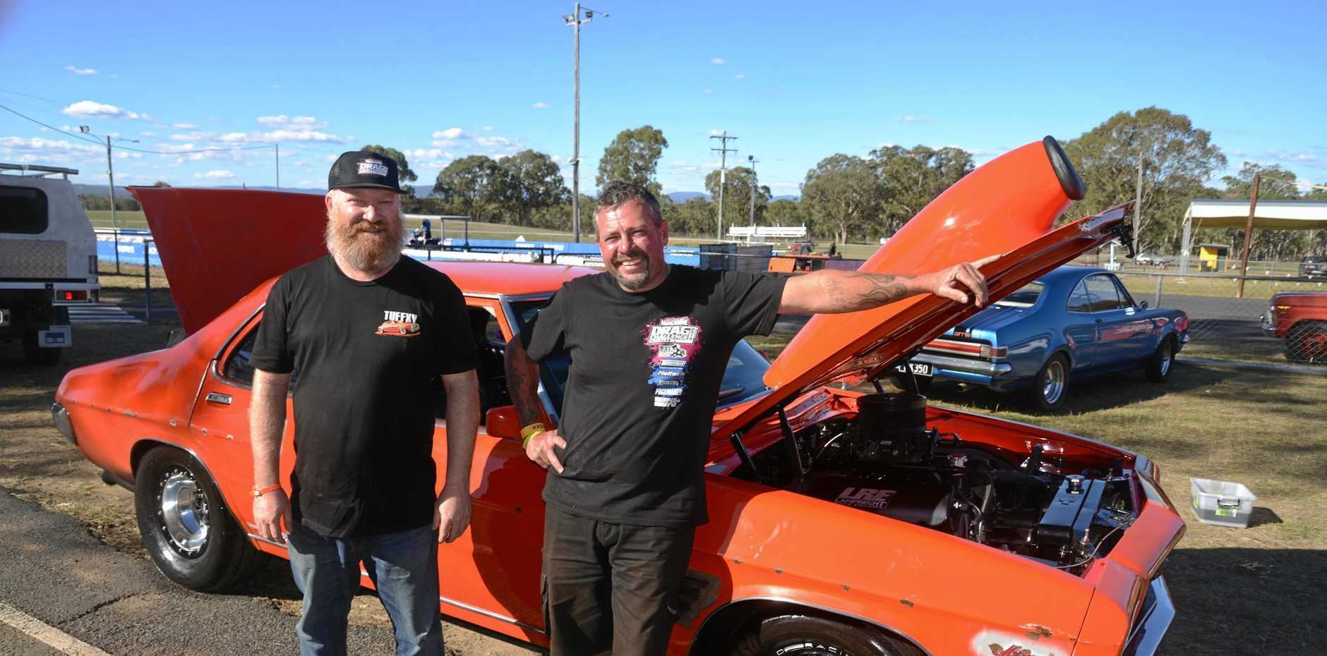 Organiser Simon Telford and driver Steve Carkeet with the GTS Monaro which was nine hours on the side of the highway being repaired on Saturday night.