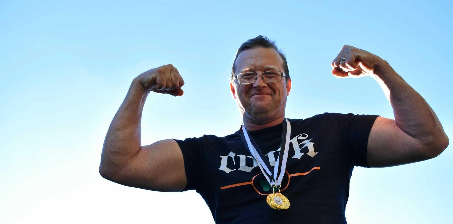 Warwick strongman Paul Driscoll won gold at the Australian Celtic Festival Highland Games in Glen Innes on Saturday.