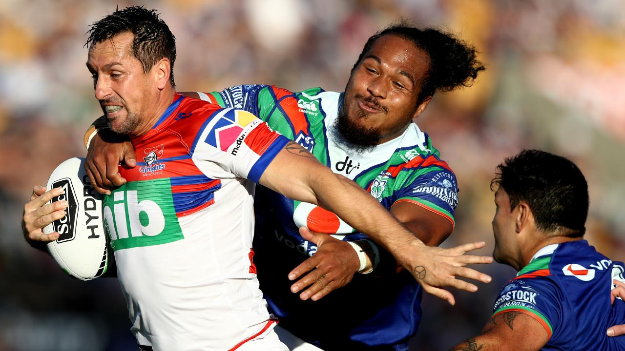Mitchell Pearce makes a break to score a try for the Knights. Picture: Getty Images