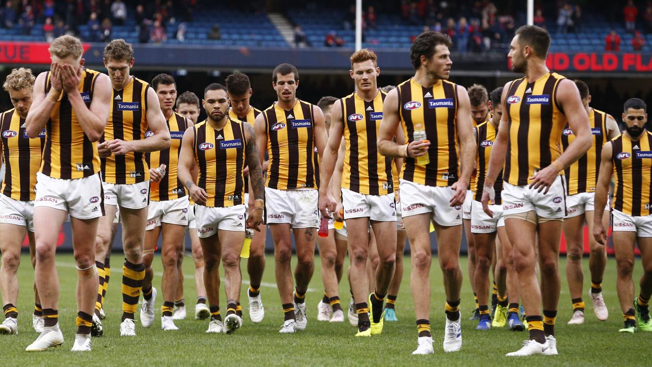The dejected Hawks leave the field after their loss to Melbourne. Picture: AAP