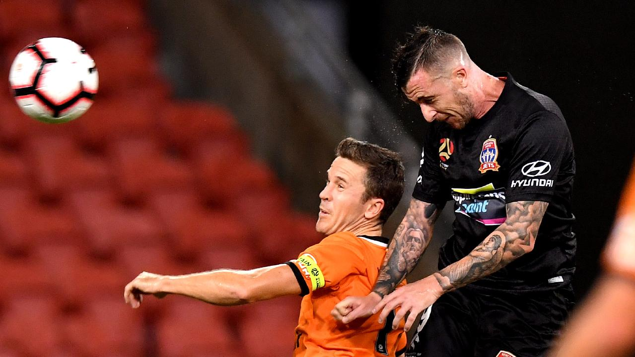 Roy O'Donovan soars above Roar skipper Matt McKay to score in Newcastle's 6-1 win over Brisbane last month. (Photo by Bradley Kanaris/Getty Images)