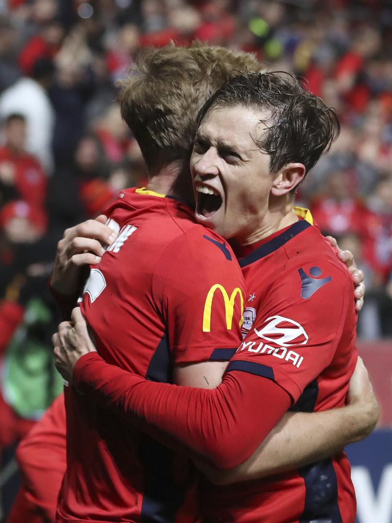 Craig Goodwin celebrates Ben Halloran's goal.