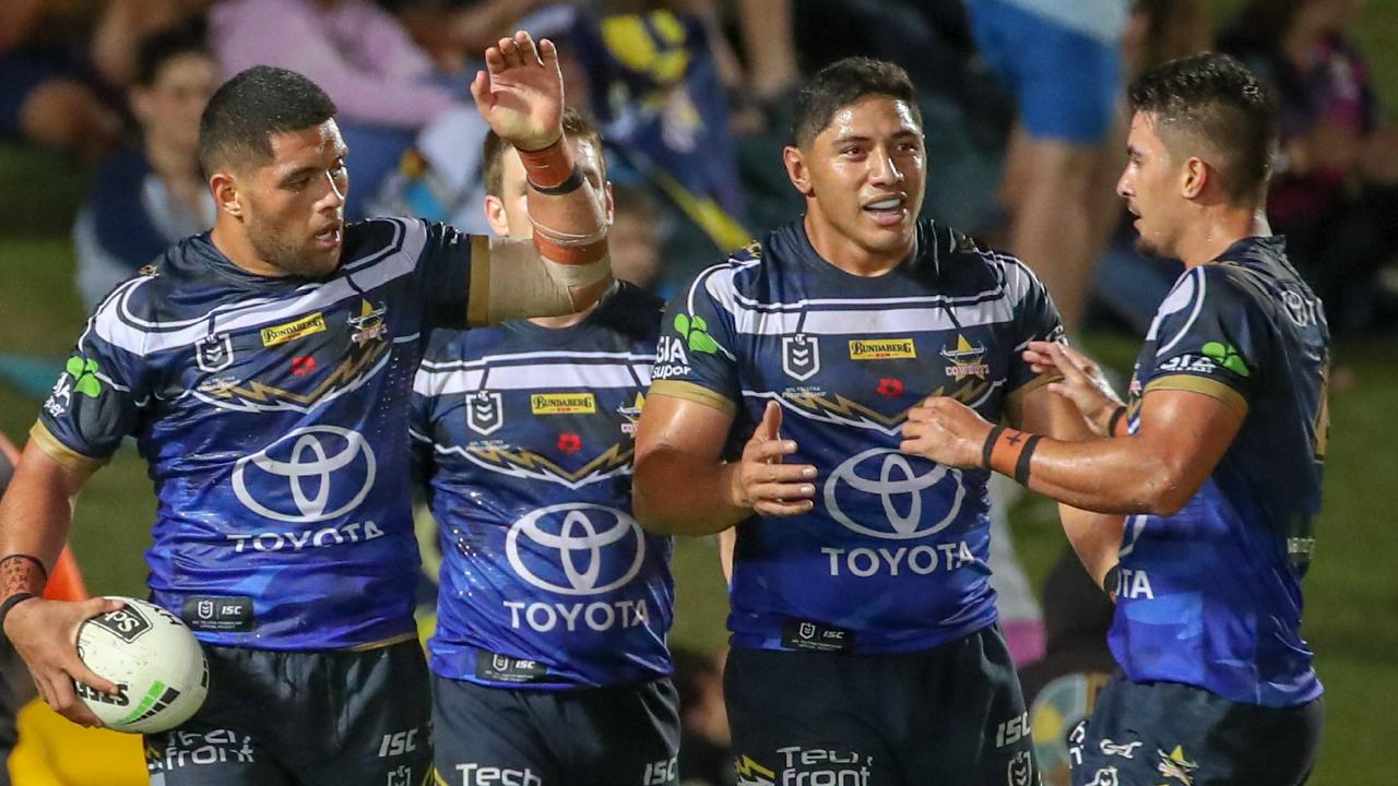 John Asiata (left) of the Cowboys is congratulated on his try by team-mates during the Round 8 NRL match between the North Queensland Cowboys and the Gold Coast Titans at 1300SMILES Stadium. (AAP Image/Michael Chambers)