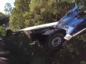 Truck leaves road