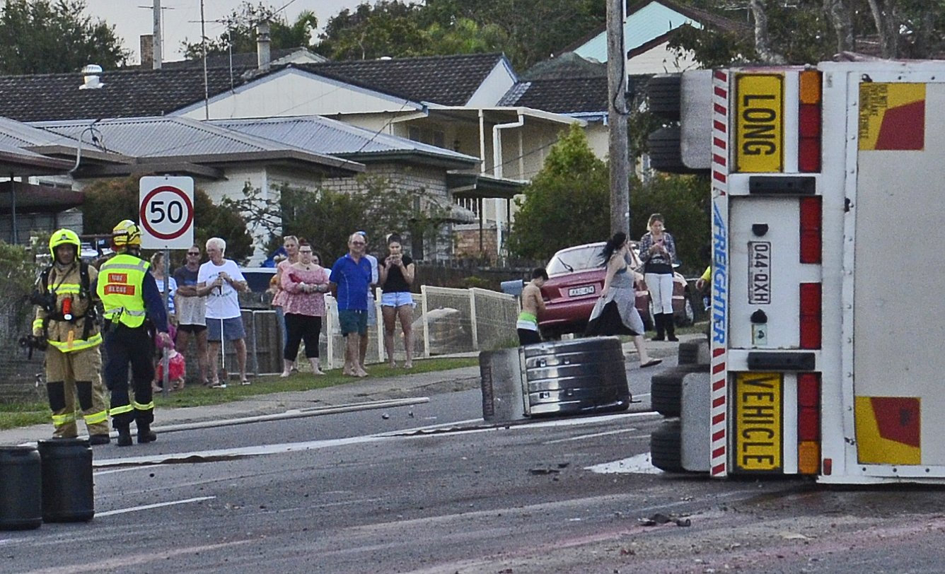 Onlookers watched as emergency services attended at the scene of a twin truck crash on the Summerland Way at Junction Hill on 22nd April, 2019.
