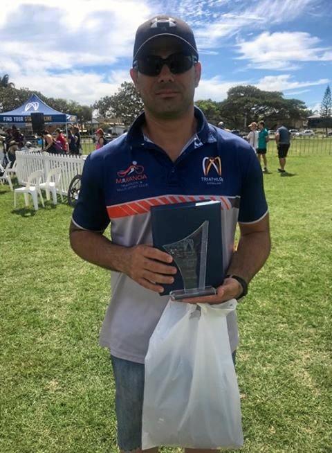 WINNER: Mick Gray with his Triathlon Queensland Regional Volunteer Award.