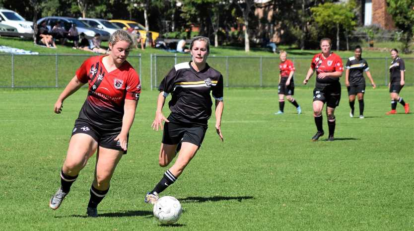 GO GIRL: Chinchilla Honeybears captain, Claire Valler taking on Toowoomba's West Wanderers.