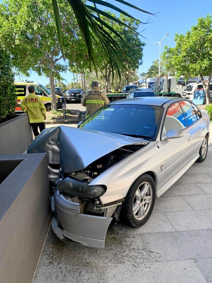 A woman has escaped injury after crashing her car into a wall in Tweed Heads.