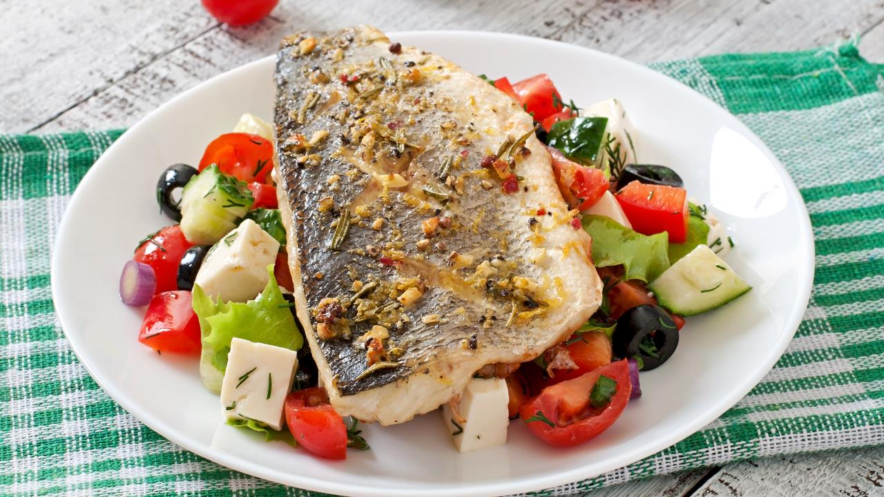 Tiff Hall says she can't get enough of Baked Sea Bass with Greek Salad for dinner. Picture: Tiff XO
