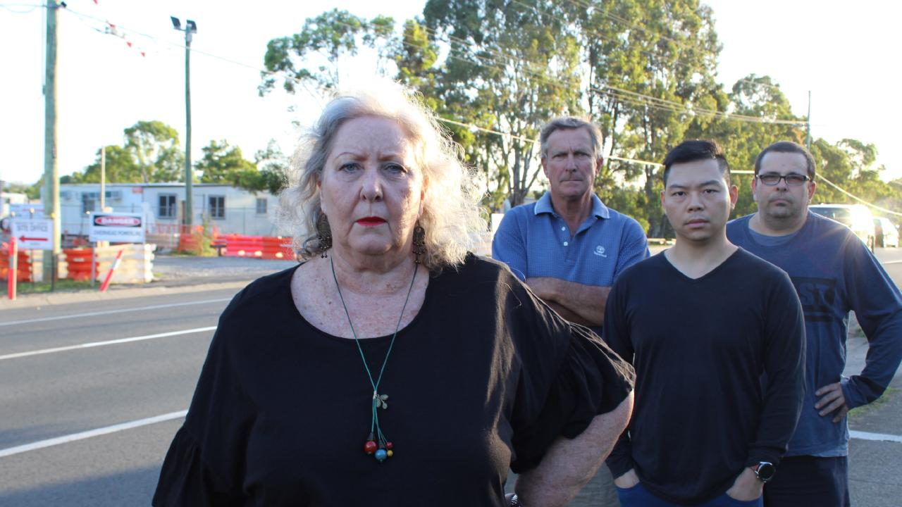 Cheryl Perkins (front) and Richard Perkins, Kevin Pan, and Michael Callice (back) are furious that the site office for the Murphy Rd and Ellison Rd upgrade has been erected right outside their homes. Picture: Ellen-Maree Elliot
