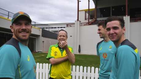 Australian Opposition Leader Bill Shorten (centre) speaks to Australian cricketers, Aaron Finch (left), Pat Cummins and Jhye Richardson at the Alan Border Field in Brisbane. Picture: AAP Image/Lukas Coch