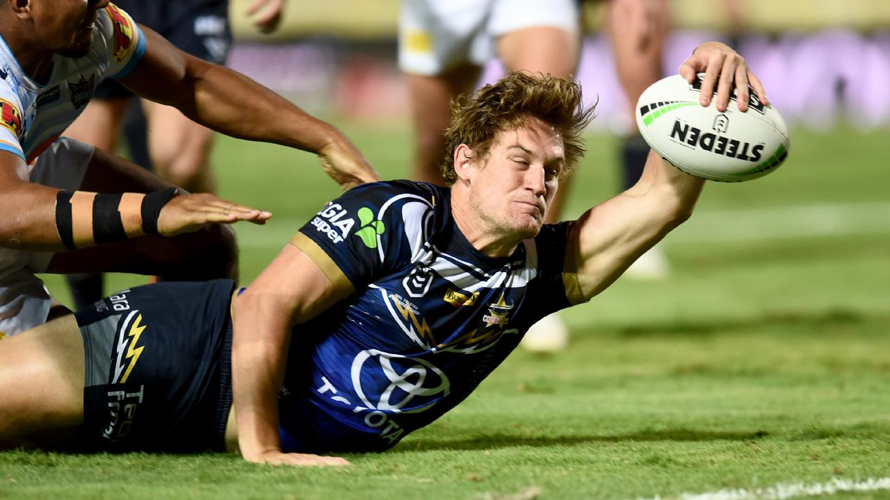 North Queensland Cowboys against Gold Coast Titans at 1300Smiles Stadium. Cowboys Coen Hess stretches for the tryline. Picture: Evan Morgan