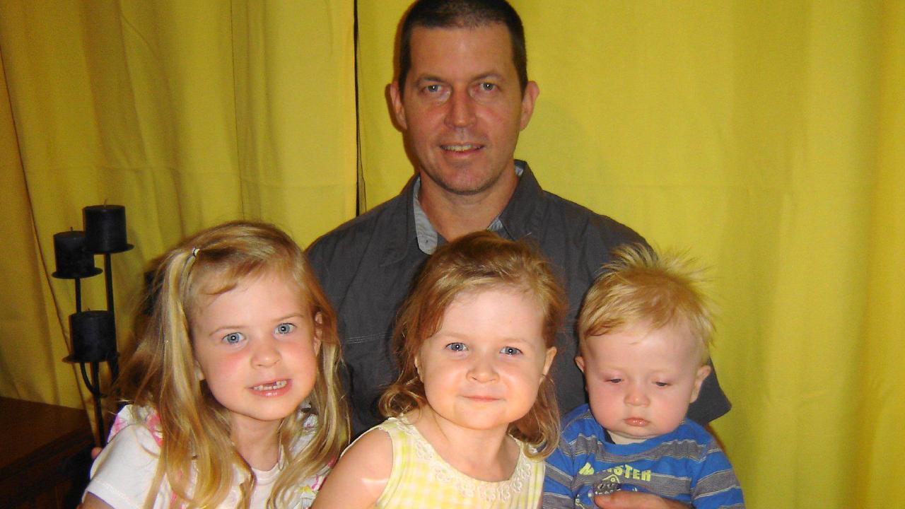 Matthew Kabealo with his three children.