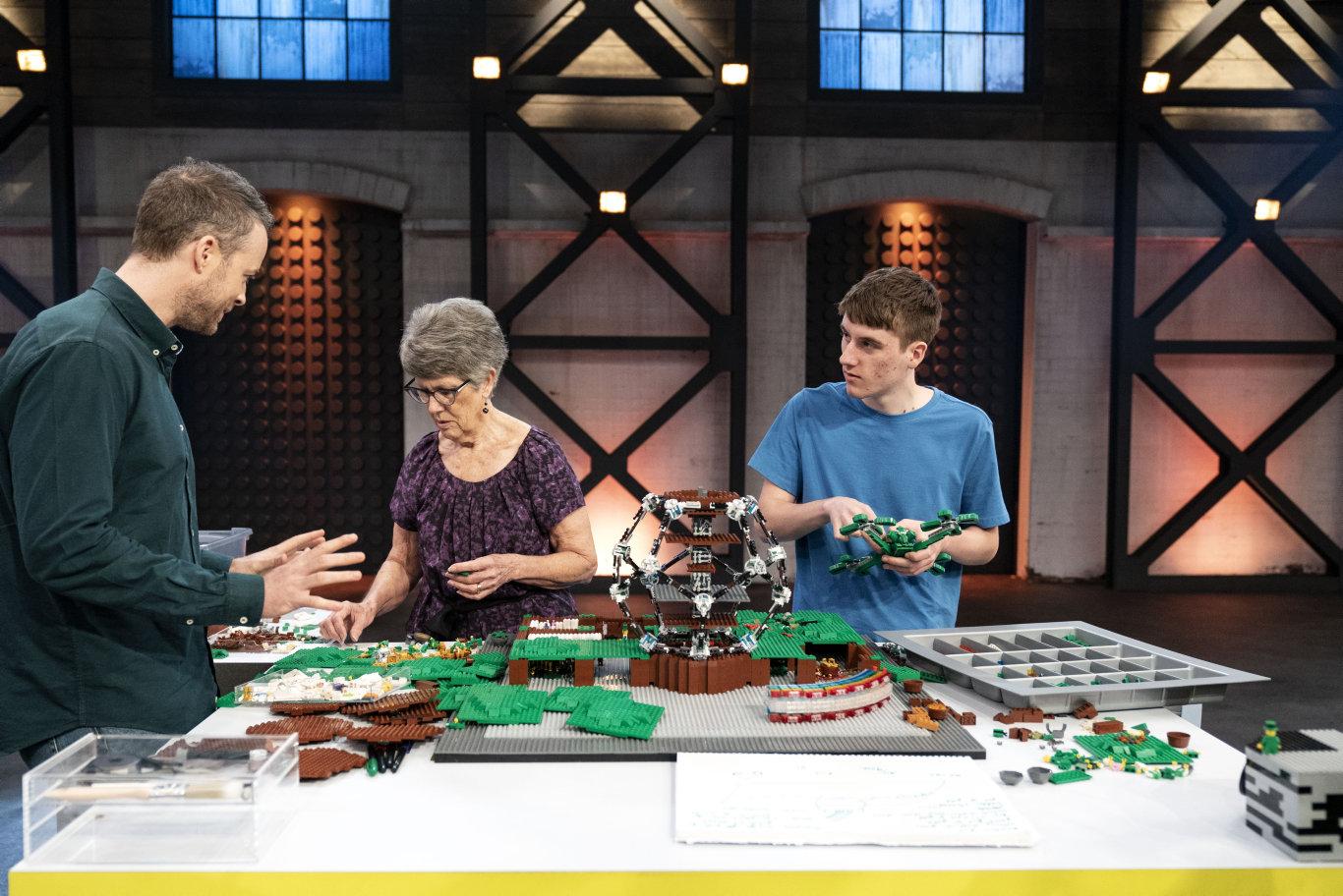 Matt and Lyn Cramb with Lego Masters host Hamish Blake.