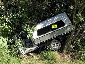 Crash leaves vehicle wedged in trees