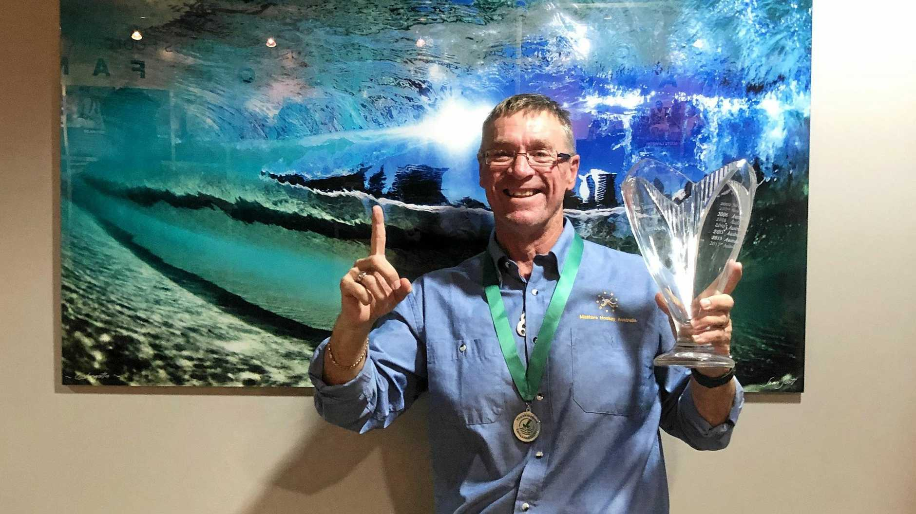 WE HAVE THE CUP: A proud Gary Porteous with the Trans Tasman Trophy. INSET: The victorious Australian over-45s team.