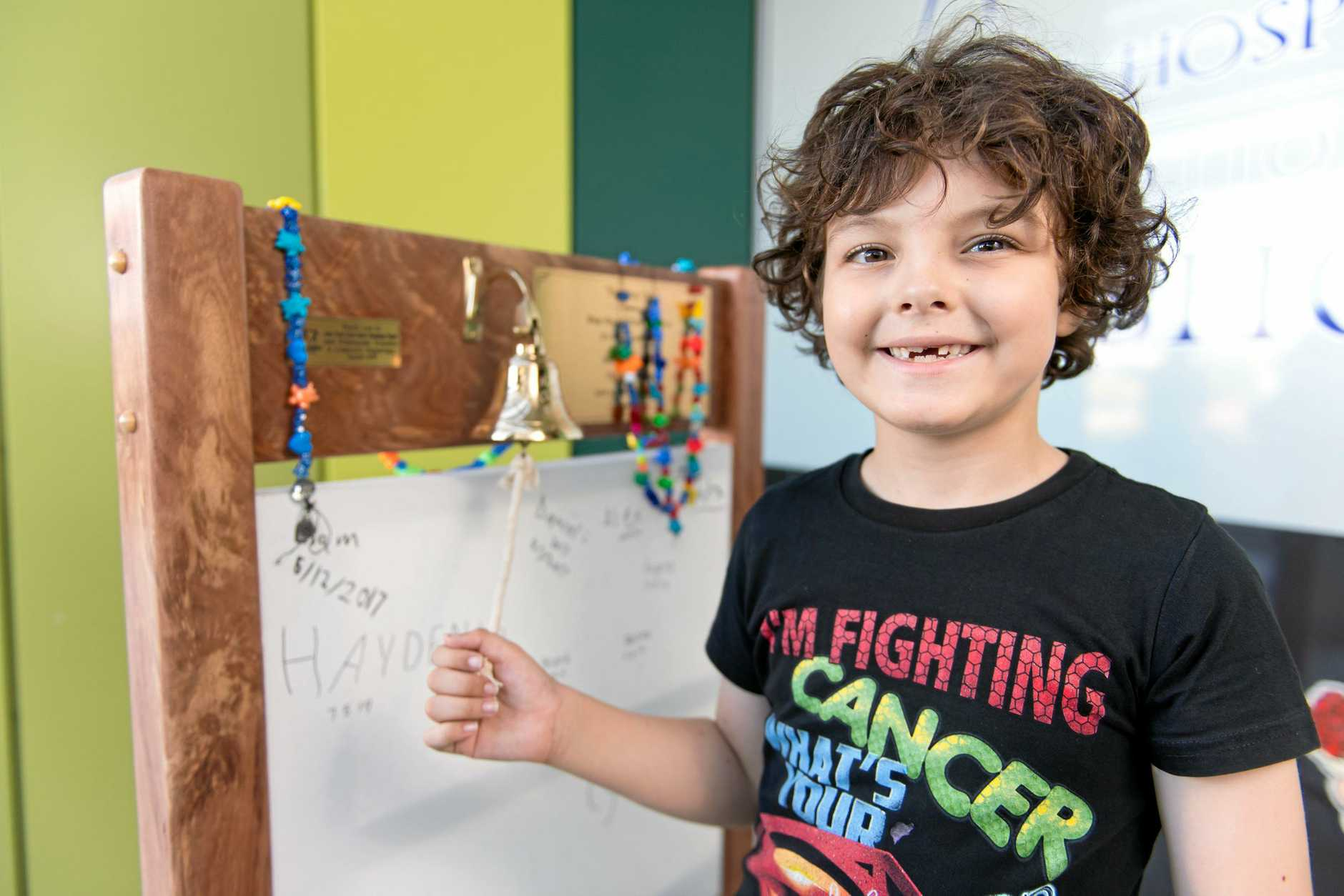 MILESTONE MOMENT: Hayden Lee rings the 'last chemo bell' after completing more than three years of treatment for leukaemia.