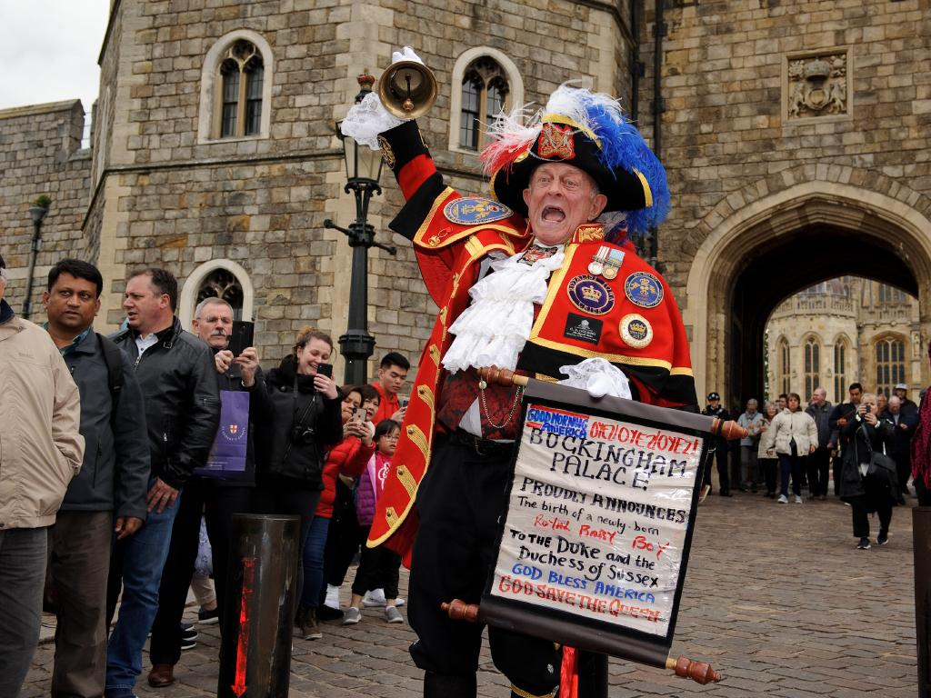 A town crier announces the birth of Meghan and Harry's baby in Windsor. Picture: Getty