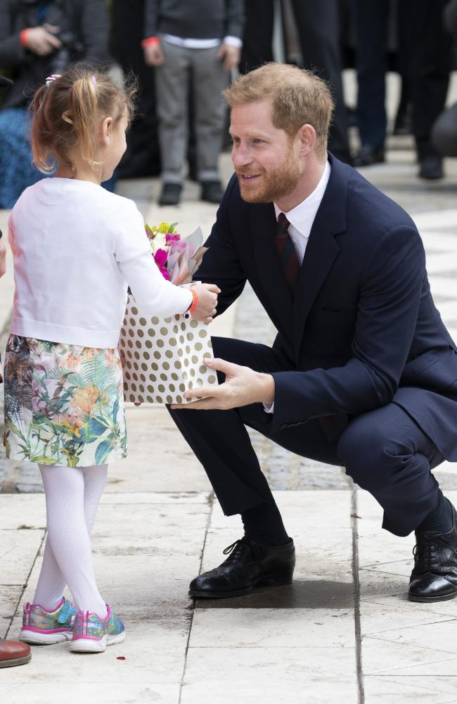 Like his mother, Prince Harry has a warm rapport with children. Here he meets a little girl outside a charity lunch at London's Guildhall. Picture: Getty Images