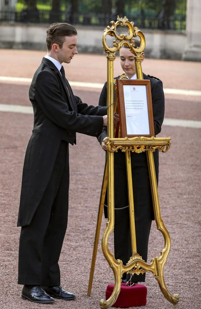 A royal birth notice is set on an easel in the forecourt of Buckingham Palace in London to formally announce the arrival of Prince Harry and Meghan's baby boy. Picture: AP Photo/Vudi Xhymshiti