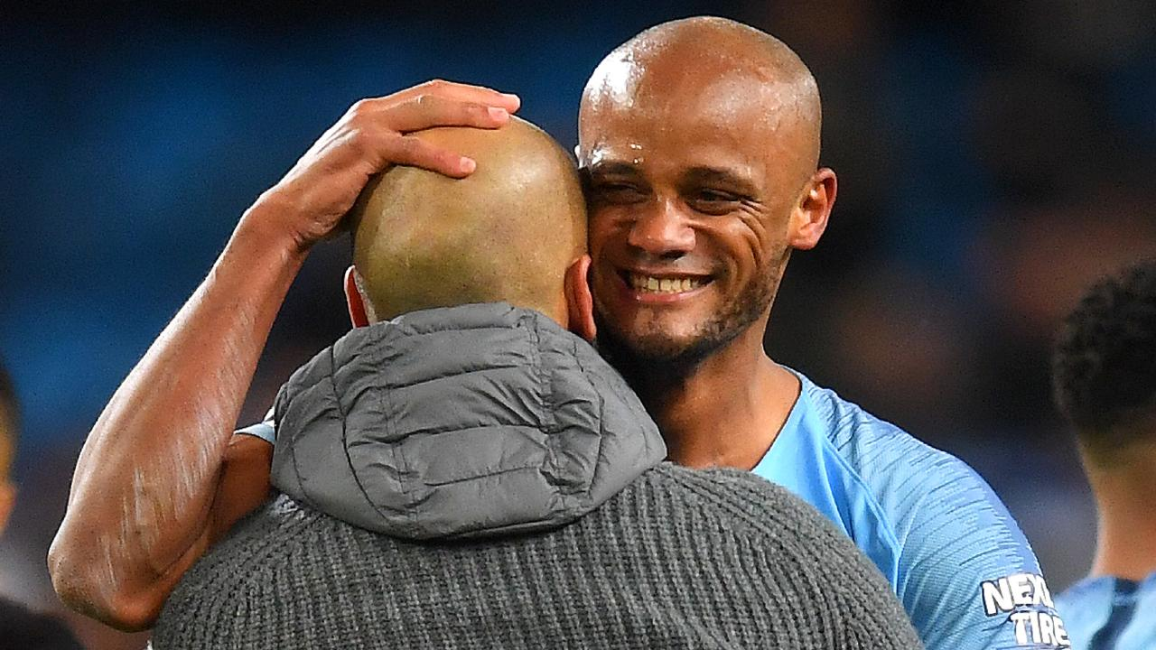 Vincent Kompany celebrates the win with Manchester City manager Pep Guardiola. Picture: Getty Images