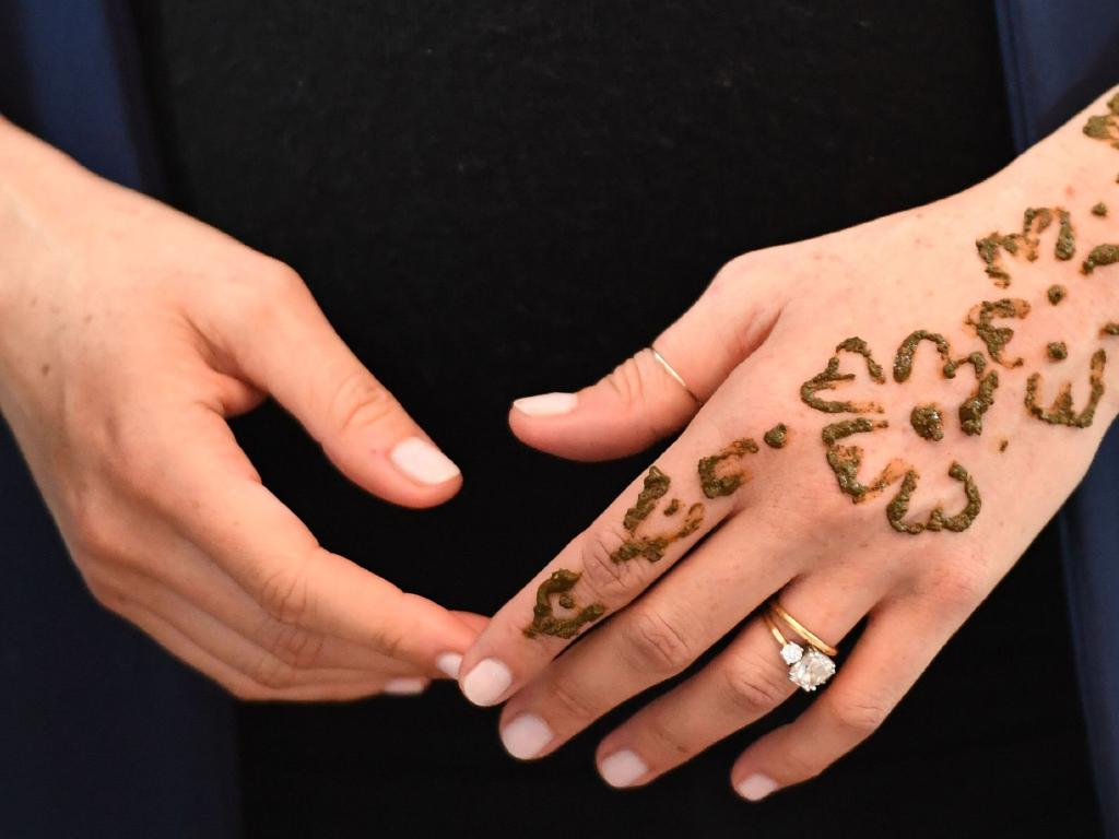 Meghan, Duchess of Sussex attends a Henna tattoo ceremony as she visits a boarding house in the town of Asni, Morocco. Picture: Getty