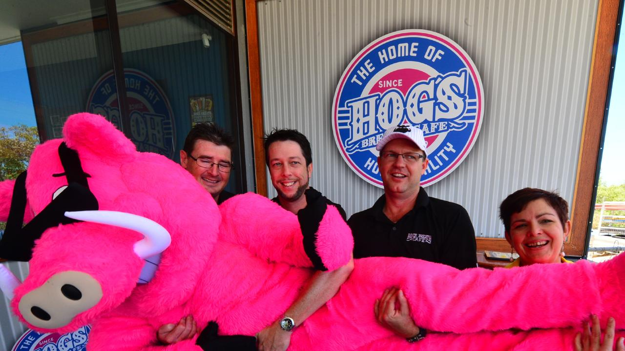 Hog's Breath franchise partners L-R Cameron Dyal, Jason Moden, Scott Peatey and Tracy Millers with the Hogster model at their new premises at Townsville Central.