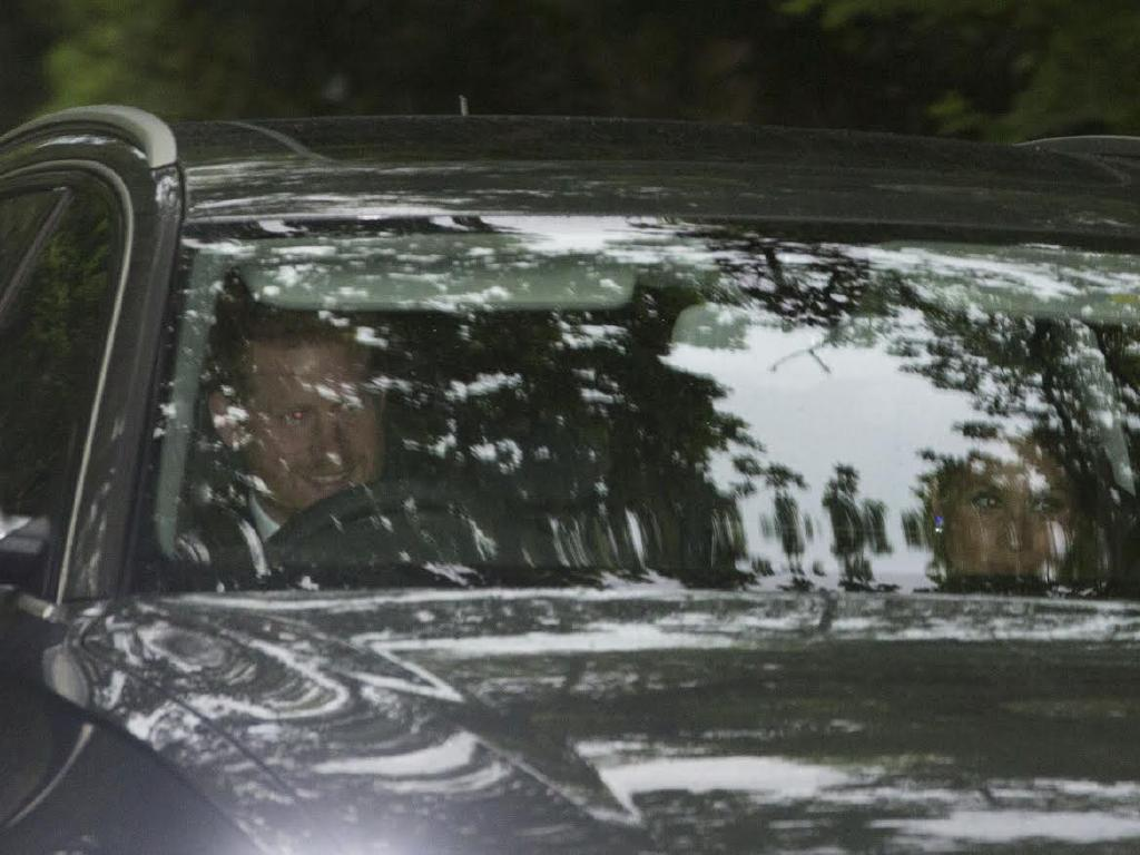 Prince Harry in an Audi drives his girlfriend, the American actor Meghan Markle, to the wedding reception of Pippa Middleton and her husband James Matthews. Picture: News Group Newspapers Ltd.