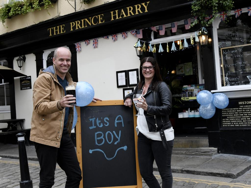 Aussies Bret and Allison Parkinson outside The Prince Harry pub in Windsor. picture David Dyson