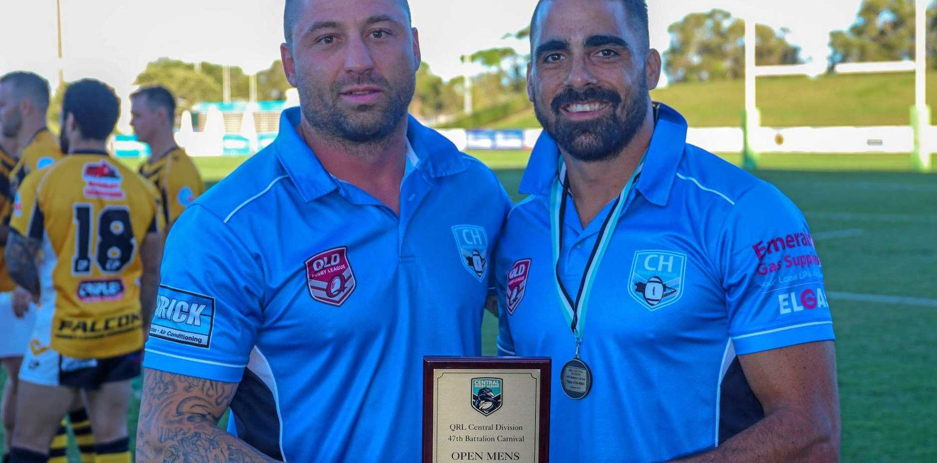 VICTORIOUS: Central Highlands men's coach Mitch Wyatte with captain Chris Conway after a 24-16 win over South West Country in the plate final.