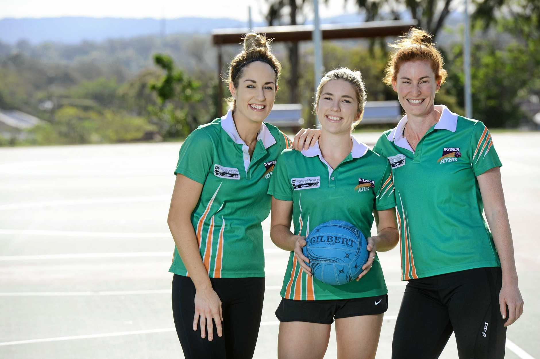 Ipswich Flyers netball players Nicole Grant, Bridget Cumming and Liz Hales prepare for the SEQ Challenge Grand Final match.