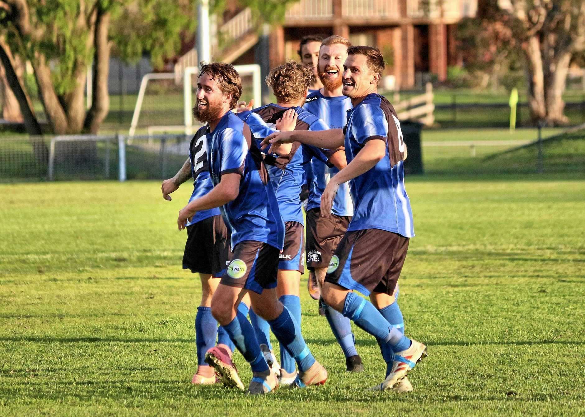 HAPPY DAYS: The Woolgoolga Wolves celebrate a goal during their 2-1 win over the Maclean Bobcats last weekend.