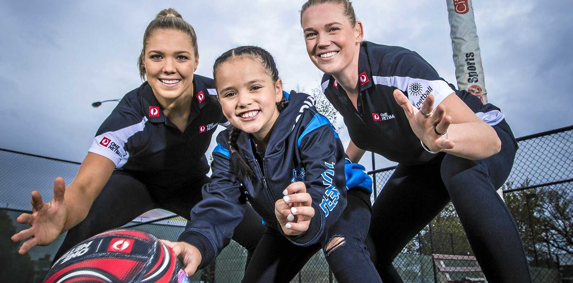Australia Post ambassadors Kate Moloney (left) and Australian Diamonds teammate Caitlin Thwaites share their excitement with Zodia Folau, 8.