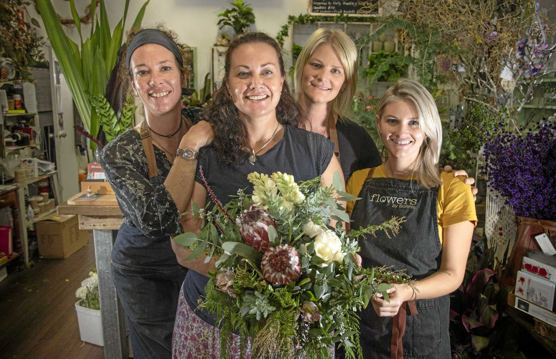 Renee Nicholson, Bonnie McGowan, Rayonnie Clarke and Hope McGowa all get in the floral action at Flowers by Bonnie - who won the Mid North Coast Brides Choice award for best florist.