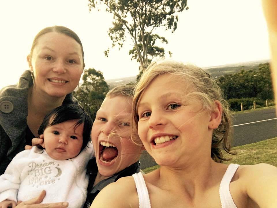 Nanango RSL manager Sheena Lindholm and her children.