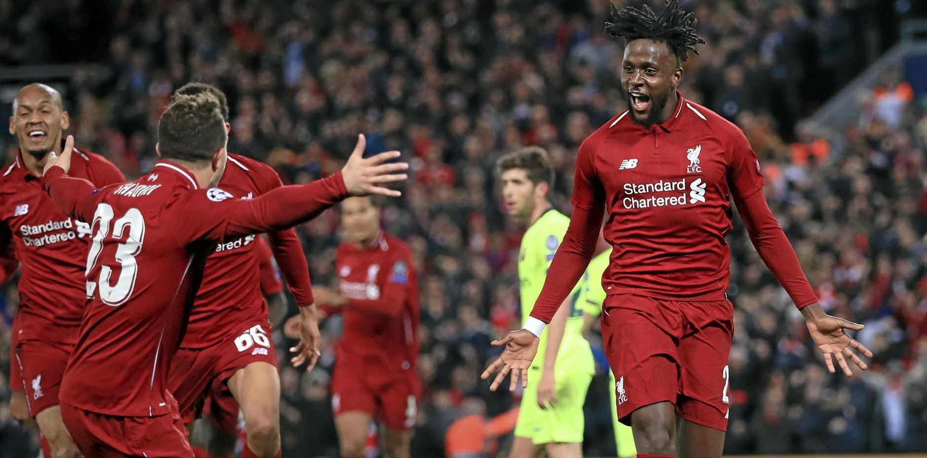 Liverpool's Divock Origi, right, celebrates scoring his side's fourth goal of the game during the Champions League Semi Final, second leg soccer match between Liverpool and Barcelona at Anfield, Liverpool, England, Tuesday, May 7, 2019. (Peter Byrne/PA via AP)