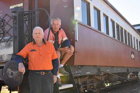 Southern Downs Steam Railway president Peter Gregory (left) and board member/public relations co-coordinator Chris Freeman encourage community members to book a train ride after numbers declined by at least 30 per cent since January.