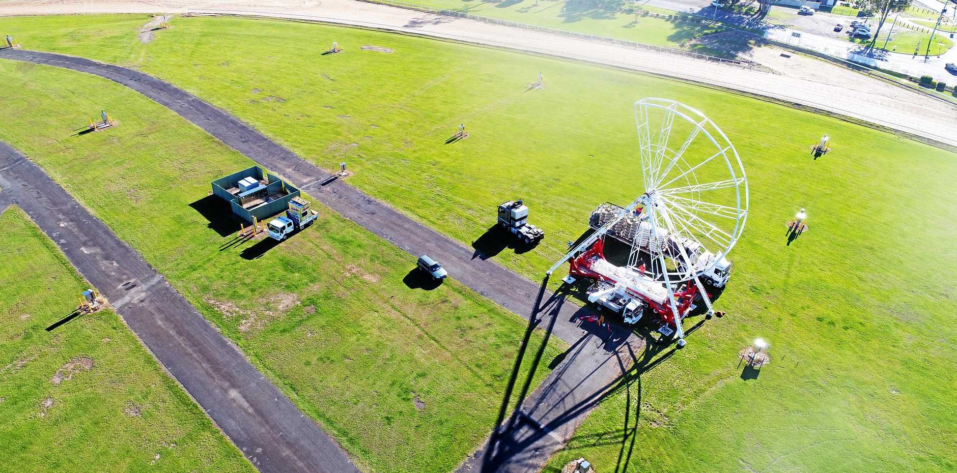 TAKING SHAPE: The ferris wheel takes shape at Gympie Showgrounds yesterday.