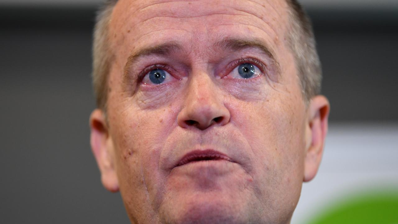 Bill Shorten holds back tears as he speaks to the media about his late mother. Picture: Lukas Coch/AAP