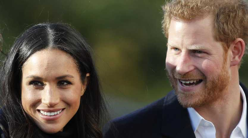 Meghan Markle and Prince Harry set up the  photo opportunity after declining to pose for the traditional  photo on the hospital steps. Picture: AP