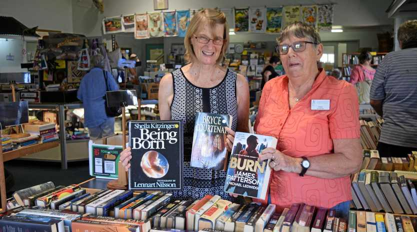 BOOKWORMS: Proserpine Museum's Jan Lade and Alisa Reinke at the Book Bonanza.
