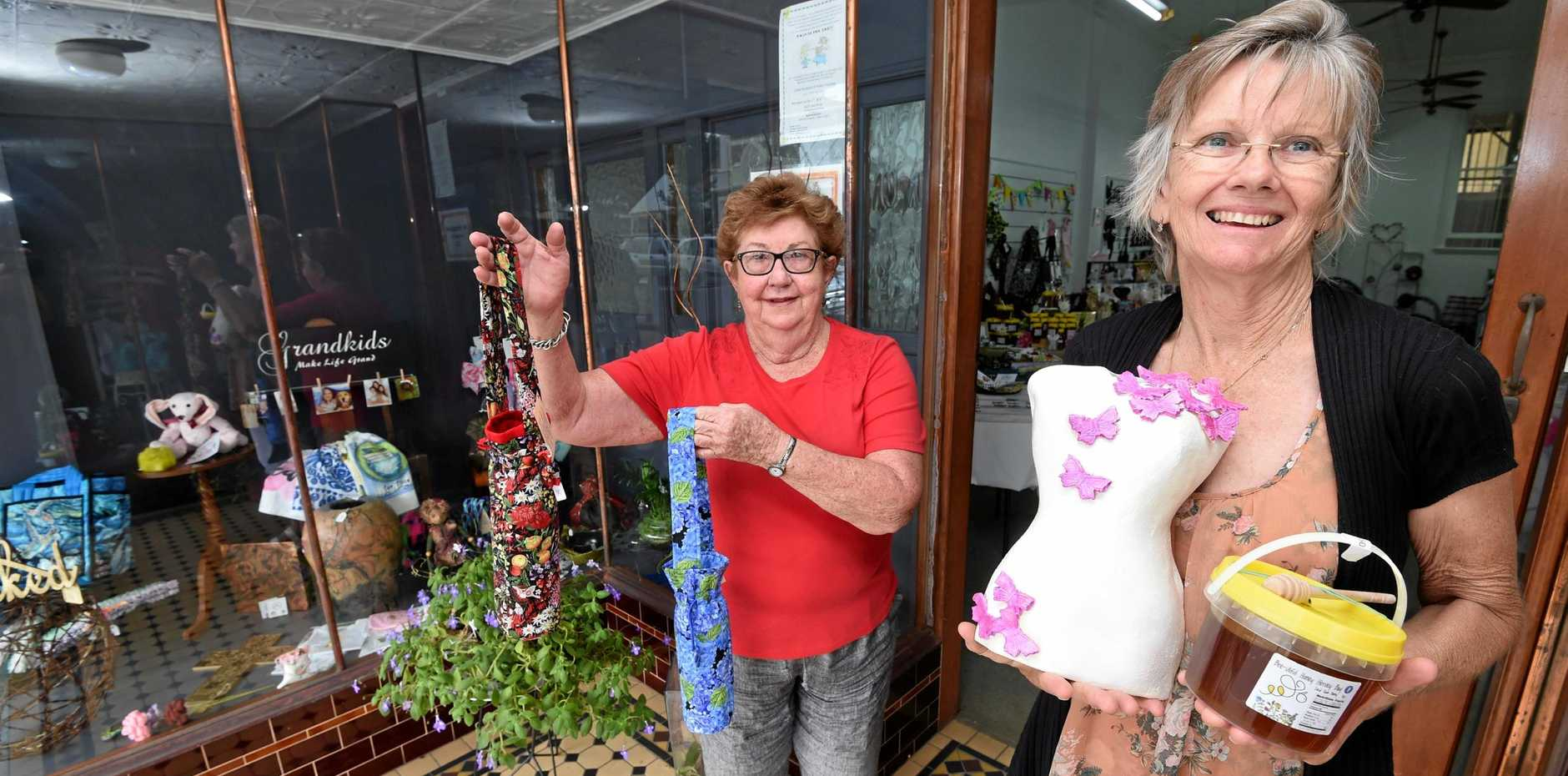 JUST FOR MUM: Lesley Mason and Jo Baker with some of the goods on sale at the Mary Maketeers' pop-up shop on Adelaide St, Maryborough.